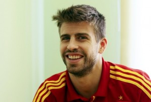 Spain's national soccer player Pique smiles during an interview with Reuters media during the Euro 2012 soccer tournament in Gniewino