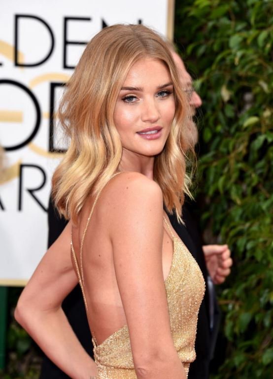 e26f6d147e6 Rosie Huntington-Whiteley rocked gold from head to toe with her bronzed,  gold eyeshadow picking up the tones in her dress. Not to be washed out by  too many ...