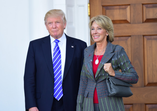 Civil rights groups sue DeVos over policy on campus sexual assault